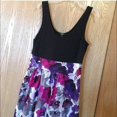 Express sz 12 fit & flare dress Express fit & flare summer dress, size 12. Black fitted top with unique floral pink, purple and grey print on the loose skirt. Side zipper and pockets. From a pet free and smoke free home. Express Dresses