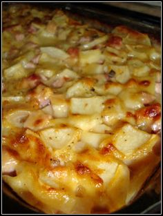HAM & SCALLOPED POTATOES - 1 can (10 3/4 oz.) Condensed Cream of Mushroom Soup, Undiluted 1 C. Milk 2/3 C. Condensed Cream of Potato Soup, Undiluted 1/2 C. Chopped Onion 1/4 C. Butter, Melted 1/2 tsp Minced Garlic 1/2 tsp Pepper 1/4 tsp Seasoned Salt 8 Medium Red Potatoes, Peeled and Thinly Sliced 3 C. Cubed Fully Cooked Ham 1 1/2 C (6 oz) Shredded Part-Skim Mozzarella Cheese