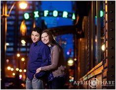 A nighttime engagement photo outside of the Oxford Hotel in Denver Colorado. - April O'Hare Photography #Colorado #DenverEngagement #DenverPhotographer #ColoradoPhotographer #Lodo #Nightphotography #OxfordHotel
