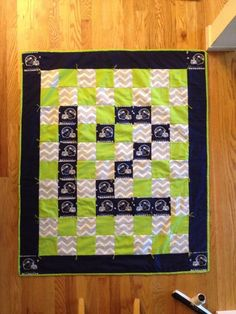 Seattle Seahawks 12th man baby quilt, but convert size to Queen and use for raffle.