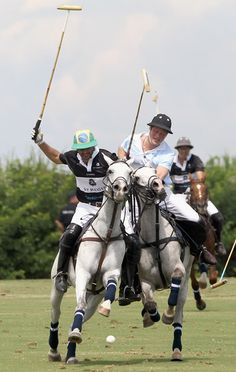 Prince Harry battles for the ball with Rico Mansur