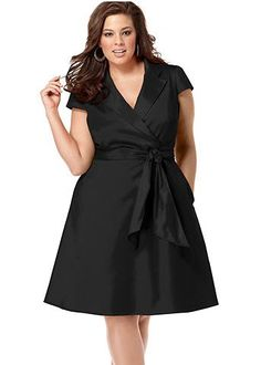 This beautiful black dress is an example of a dress style that works for your body type. The A-line skirt flares away from the body and shows off your shapely calves! The wrap style and deep V-neck draw attention to the above the natural waist and just under the bust, creating a beautiful hourglass shape.