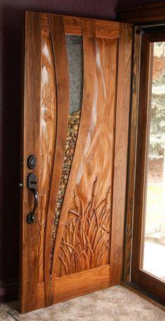 Custom Made Walnut Entry Door. Glass with river rocks inside