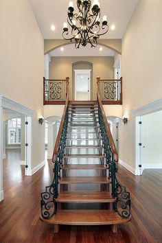 Brand new home luxury foyer with upper landing and a straight stair case. Interestingly, there are no risers on these stairs, which makes the room more open. Open Entryway, Entryway Stairs, Open Stairs, Foyer Staircase, Basement Stairway, Staircase Makeover, Staircase Ideas, Floating Stairs, Entryway Ideas
