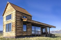 Little Lost Cabin, a small square-log cabin on acres of Idaho ranchland. The 800 sq ft cabin has an open bedroom and a loft. Tiny House Cabin, Cabin Homes, Log Homes, Tiny Homes, Dream Homes, Little Cabin, Little Houses, Ideas De Cabina, Cabin Plans