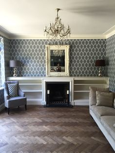 Newly decorated lounge in Farrow and Ball Tessella wallpaper and Slipper Satin paint