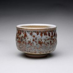 ceramic tea bowl, pottery cup, teacup with iron stain and layered orange shino glazes. This stoneware tea bowl's unique color was created by layering shino glazes over a light iron wash.