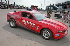 Henry Ford III taking a ride in the Hodgeford.com 2012 Ford Mustang Cobra Jet at Tulsa Raceway Park
