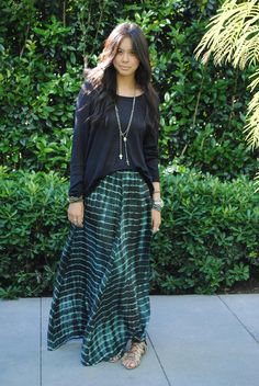 how to wear a tie dye skirt...stay warm add a loose black sweater to a green tie dye maxi...strut in sandals to make it a spring look.