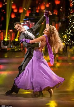 Back for more:2013 winner Abbey Clancy was just behind Harry as she performed a Waltz to 'When I Fall in Love' with pro partner Brendan Cole, scoring 39, with the judges hailing her 'grace and elegance'