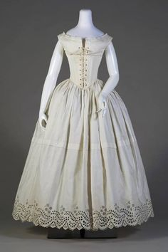 c.1845 undergarments. The top is a boned chemise which would take the place of a separate chemise and corset.