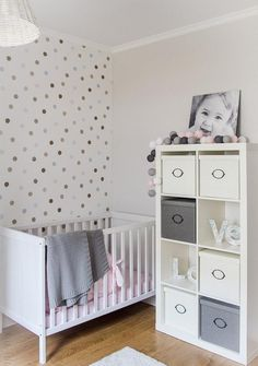 Bedroom: Grey Wall Design Baby Nursery Ideas Above Large Soft Carpet Floor Have Some Doll On Baby Room from Realizing Baby Nursery Ideas on Budget