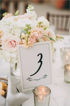 Simply elegant table numbers with pink and white floral centerpieces. Captured By: Lauren Scotti Photography http://www.weddingchicks.com/2014/06/06/shabby-chic-plaza-wedding/