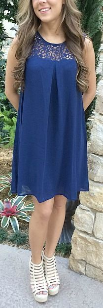 "Effortlessly elegant navy dress. Transitional dress that can be worn at any occasion. Length: 34"". 60% Cotton, 40% Polyester."