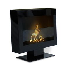 Anywhere Fireplace. You can put it together in a couple minutes, and it can even be hung on the wall without it being a fire hazard. Uses bio-ethanol to burn, so no gas or chimney needed.