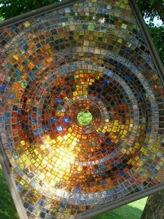 Glass mosaic on a clear glass base, brilliant for a stained glass window alternative!