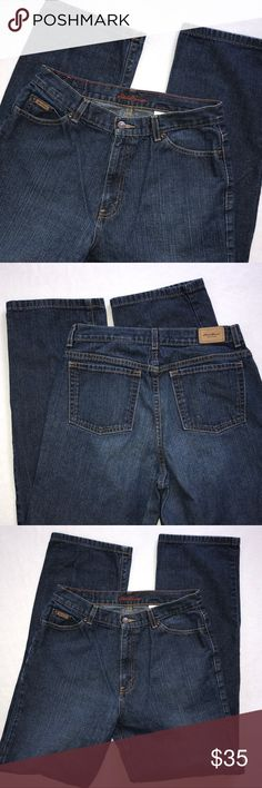 """Eddie Bauer Dark High Waist Mom Jeans Tall Long Eddie Bauer Premium Denim high waisted Mom jeans in dark wash. Zip fly with button.  100% cotton. Size 12 Tall.   Approx measurements:  waist across laying flat 14.75"""",  rise 11.5"""", inseam 33"""", leg opening 8.75"""".  In excellent condition.  Small amount of gray beginning on hems. Eddie Bauer Jeans Straight Leg"""