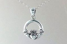 My classic Celtic Claddagh necklace was designed in solid Sterling Silver. This is a smaller sized Claddagh and is very popular for Celtic Themed weddings or as Bridesmaid gift. It measures 22mm or .87 inches and comes with your choice of a 16 or 18 inch Sterling chain.   The classic Irish Claddagh represents love (heart), loyalty (crown) and friendship (hands). Its a perfect gift for someone you hold dear in your life.   All pendants include your choice of either a 16 or 18 solid Sterling…