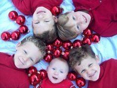 Cute, but I could never get all four kids to do this at once...I agree, couldn't get my 5 to do it either but it's worth a try for a cute Xmas photo