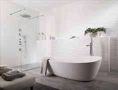 Textured wall tile with stone floor (Porcelanosa: Oxo Line Blanco)