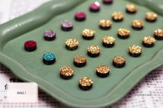 DIY Refrigerator Magnets | Glitter magnets. I love this simple idea! Just dip one side of the magnet in Elmer's glue and then dip it in glitter. That's it!