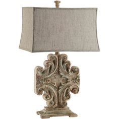 A lovely addition to any room, the base of the Sonia resin table lamp was inspired by a vintage scroll. This elegant lamp is both timeless and trend-setting, highlighting a rectangular woven fabric shade.