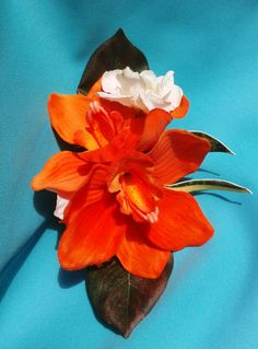 Hawaiian Orange Orchids Hair clip with Accent Flowers and Tropical Greenery.