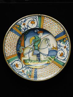 Dish    Place of origin:  Deruta, Italy (made)    Date:  1520-1550    Artist/Maker:  Mancini, Giacomo (workshop of, made)    Materials and Techniques:  Tin-glazed earthenware, painted with colours  V, 2595-1856