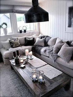 20 fantastic grey living rooms - The Grey Home. I like that coffee table for outside