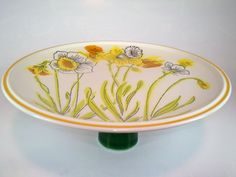Handmade kitsch cake stand. Made from a vintage plate and a vintage ceramic cup. For sale at AlienVintage on Etsy.com.