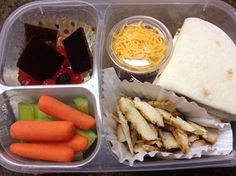 Build your own chicken tacos. Celery and carrots. Some fruit snacks and fruit leather pieces. also a hidden piece of chocolate ;)