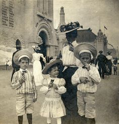 """Waffle ice cream cone eaters, 1904 St. Louis Fair. Legend has it the Fair may have been the first place such cones were used. """"During the 1904 St. Louis Worlds Fair, The Banner Creamery's owner George Bang was selling ice cream. Allegedly, he ran out of bowls and was given rolled-up waffles to serve it in instead."""" Wiki"""