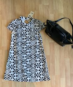 Yumi dress ($117), Ted Baker tote ($291.75)