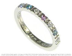 This platinum eternity ring holds a 2mm brilliant cut London Blue topaz, aquamarine, light pink tourmaline and three H SI diamonds each stone representing ...