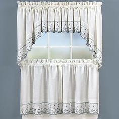 I like this type of drape, because it does not need tiebacks, but it still frames the window.