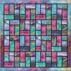 "Stained glass quilt pattern using batiks -the black sashing really makes the fabrics zing. A simple method of adding 1/4"" sashing makes this an easy pattern"