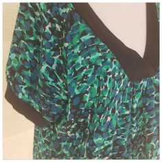 V neck blouse with blues and greens Beautiful v neck blouse with blues and greens. Cute bands on sleeves and neckline trimmed in black. Banded bottom to give a flattering figure. Size 2x. Measures 25 bust 30 length a.n.a Tops Blouses