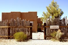 adobe home with coyote fencing