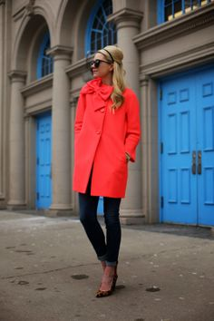 Chic coat, chic colour, chic bow.