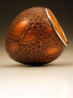 """David Huang: This vessel was formed through traditional angle raising techniques and further embellished with chasing techniques. The approximate size is 4.25"""" x 3.75"""" x 3.75"""". It is made of copper, sterling silver, and 23-karat gold leaf. Currently it is SOLD"""