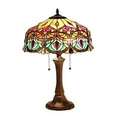 Handcrafted using the same techniques that were developed by Louis Comfort Tiffany in the early 1900s, this beautiful Tiffany-style piece contains over 445 hand-cut pieces of Art glass. Setting: Indoo