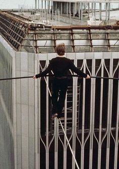 Here are harrowing photos of the original daredevil stunt that inspired 'The Walk'