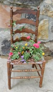 Unused chair into a flower planter