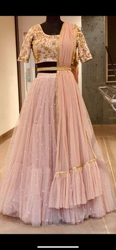 Gorgeous blush pink color layered lehenga and blouse with net dupatta. Lehenga and blouse with floret lata design hand embroidery gold thread work. Indian Wedding Gowns, Indian Bridal Outfits, Indian Gowns Dresses, Bridal Gowns, Designer Bridal Lehenga, Bridal Lehenga Choli, Net Lehenga, Pink Lehenga, Designer Party Wear Dresses