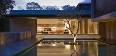ONG&ONG architects have designed the House in Bukit Timah, Singapore. The house comprises of three volumes positioned around a centra. Residential Architecture, Interior Architecture, Cubic Architecture, Asian Architecture, Sliding Door Systems, Sliding Doors, Sliding Panels, Casa Patio, Patio Doors