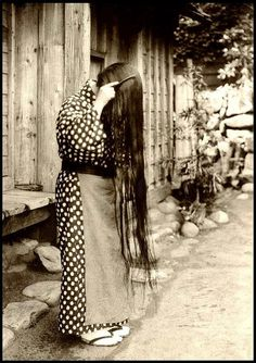 AN OSHIMA ISLAND GIRL OF OLD JAPAN COMBING OUT HER LONG HAIR