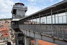 """Discover Santa Justa Lift in Lisbon, Portugal: This Industrial Age architectural and engineering gem helps visitors and residents alike traverse Lisbon, """"The City of Seven Hills. Hotel Inn, Downtown Hotels, Small Luxury Hotels, Find Hotels, Most Visited, Tourism, Around The Worlds, City, Building"""