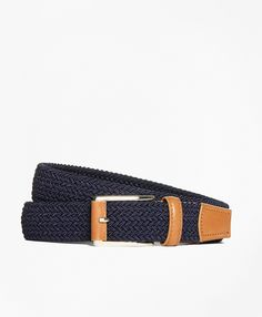 """Woven stretch belt made with premium leather detailing and durable elasticated textile weave. Made in Spain. 1.4"""" width.  Imported."""