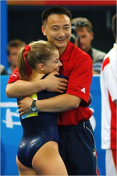 Liang Qiao congratulates gymnast Shawn Johnson of the USA after her routine in the beam final at the 2008 Olympic Games