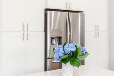 White shaker cabinets with bushed nickel hardware from Premium Cabinet Studio